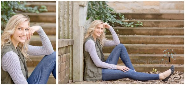 Beautiful blonde high school graduate in denim and soft green vest seated in front of stone staircase